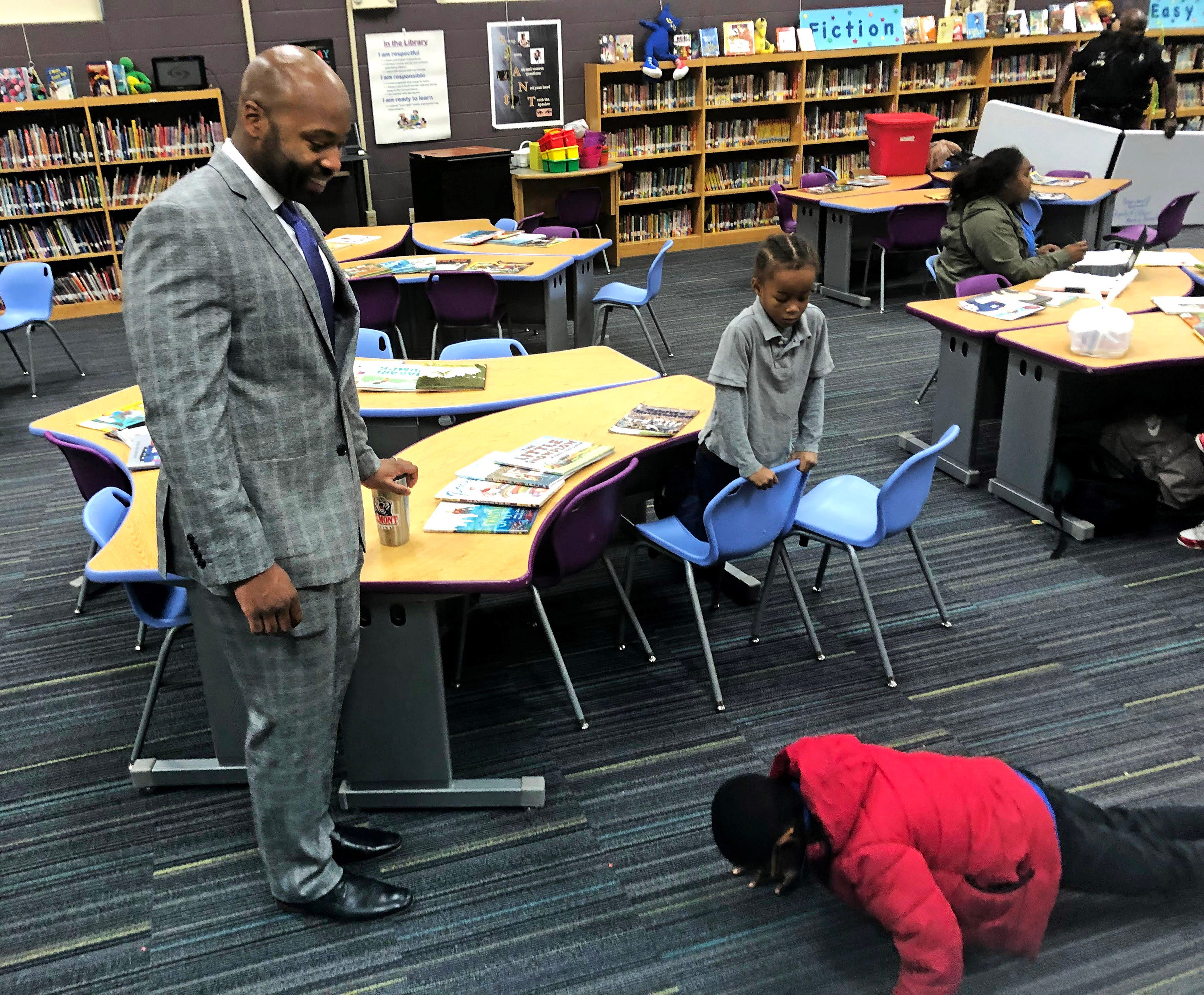 Xavier Purdy, 33, was a first-time participant in Fatherhood Fridays. Purdy is with I'zaa Bryant and Tyrell Kirkwood, who is doing pushups.