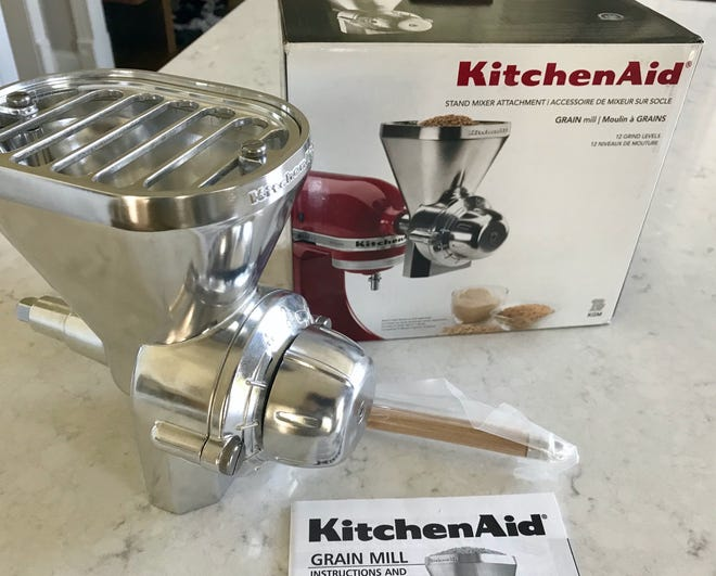 Home flour mill prices begin at just over $100, including this Kitchen Aid Grain Mill attachment that turns a stand mixer into a mill.