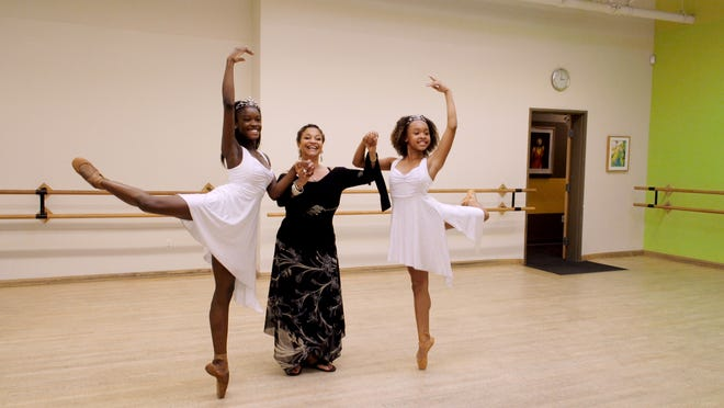 "Debbie Allen center, guides dancers Destiny Wimpye and Jalyn Flowers through their steps in ""Dance Dreams: Hot Chocolate Nutcracker."""