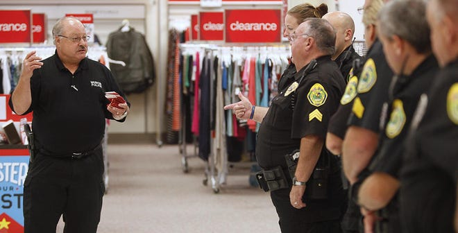 Chuck Hensley goes over instructions during one of the annual Helpers & Heroes events in this Star Press file photo.