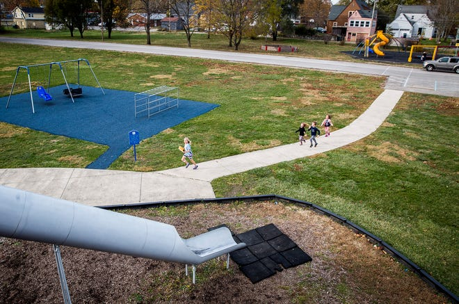 """Children play """"freeze tag"""" at Tuhey Park in Muncie Thursday, Nov. 5, 2020. The YMCA plans to build a new facility at Tuhey Park and subsequently close its Northwest and Downtown locations."""