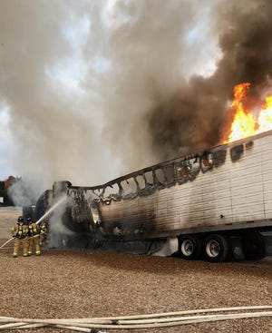Smyrna Fire Department crews battled flames that engulfed a tractor-trailer Thursday afternoon on South Lowry Street.