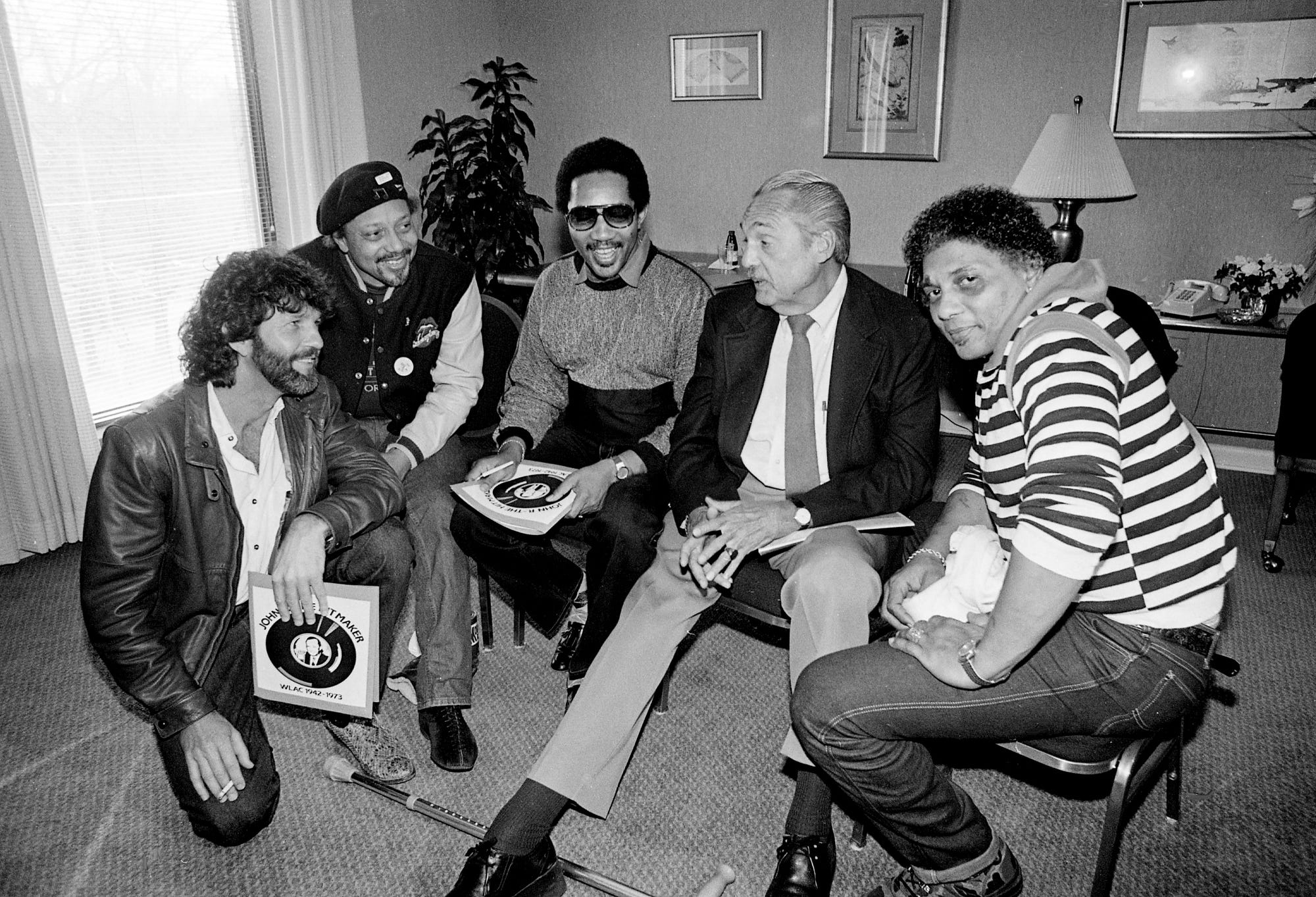 """Veteran WLAC rhythm & blues deejay Hoss Allen, second from right, begins planning the star-studded March 26 Opry House concert that will benefit his cancer-stricken radio brother John R. (Richbourg) March 6, 1985. Among the celebrities who joined """"The Hossman"""" at the Spence Manor are Tony Joe White, left, Art Neville, Bobby Jones and Aaron Neville, all of whom were aided by John R.'s pioneering broadcasts of soul sounds."""