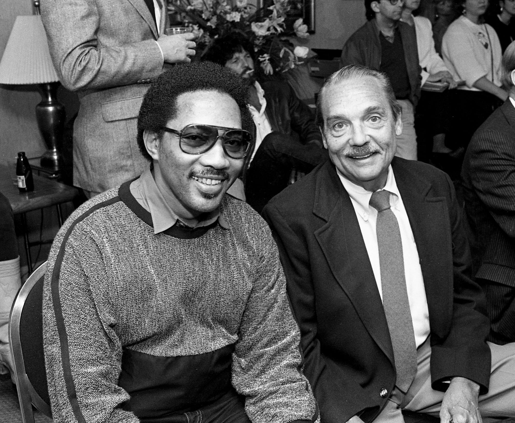 """Veteran WLAC rhythm & blues deejay Hoss Allen, right, begins planning the star-studded March 26 Opry House concert that will benefit his cancer-stricken radio brother John R. (Richbourg) March 6, 1985. Among the celebrities who joined """"The Hossman"""" at the Spence Manor is Bobby Jones, left, who was aided by John R.'s pioneering broadcasts of soul sounds."""