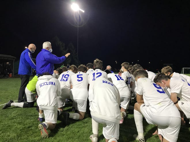 Detroit Catholic Central prays after its win against Mattawan.