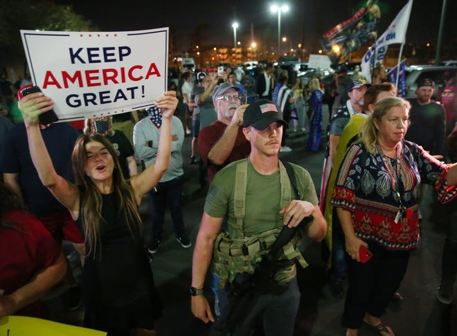 Supporters of President Trump protest outside the Maricopa County Election Center in Phoenix on Nov. 4, 2020. The group was asking for a fair vote count.