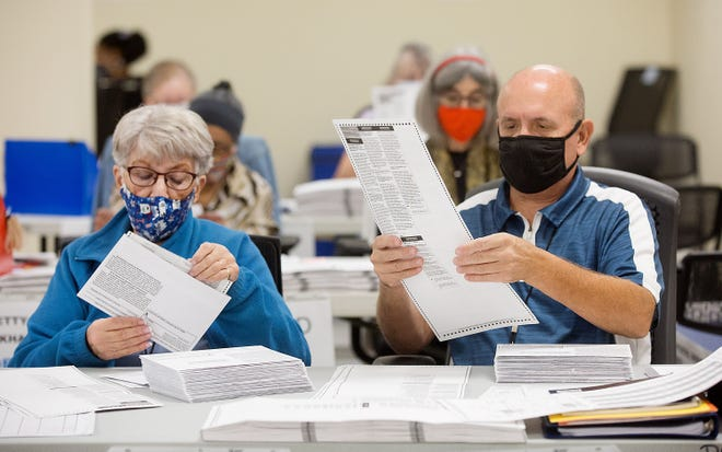 Election workers continue their work in preparing ballots in order for them to be counted later in the day the Pima County Elections Center on Nov. 5, 2020.