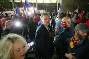 U.S. Rep. Paul Gosar, R-Ariz., walks with supporters of President Donald Trump as they protest outside the Maricopa County Elections Department in Phoenix on Nov. 4, 2020. The group was asking for a fair vote count.