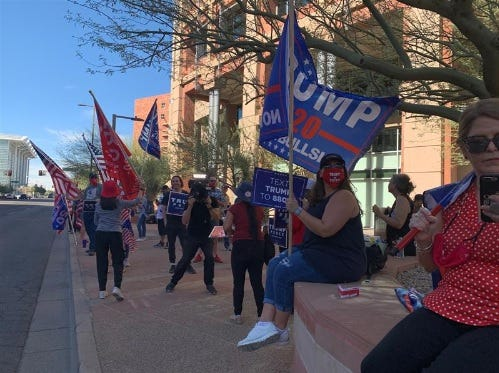 About 50 to 60 protesters gathered outside Phoenix City Hall on Thursday morning, Nov. 5, 2020, to support President Donald Trump and demand county elections officials count all votes.