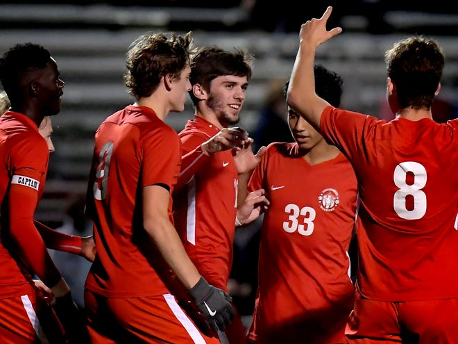 Susquehannock players celebrate a goal by Nick Holloway, center, against Daniel Boone in a District 3 Class 3-A boys' soccer quarterfinal at Susquehannock Wednesday, Nov. 4, 2020. The Warriors went on to win 5-3. Bill Kalina photo