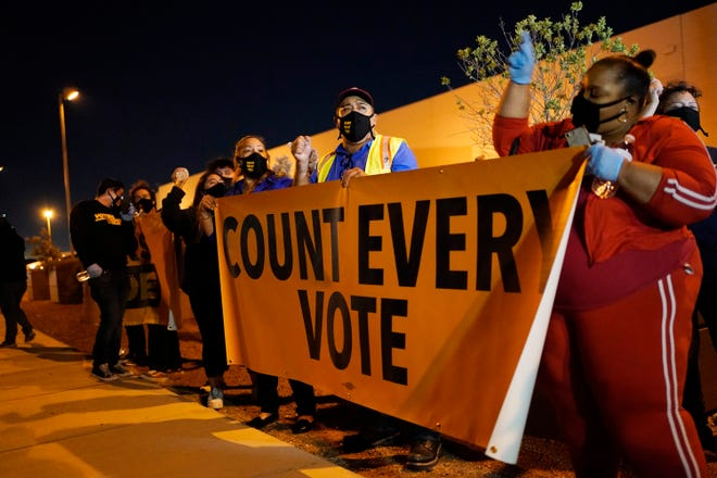 People protest in support of counting all votes in the Nevada vote in front of the Clark County Election Department, Wednesday, Nov. 4, 2020, in Las Vegas.