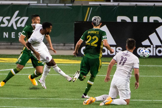 Colorado Rapids midfielder Kellyn Acosta (10) shoots the ball for a goal against the Portland Timbers during the second half at Providence Park.
