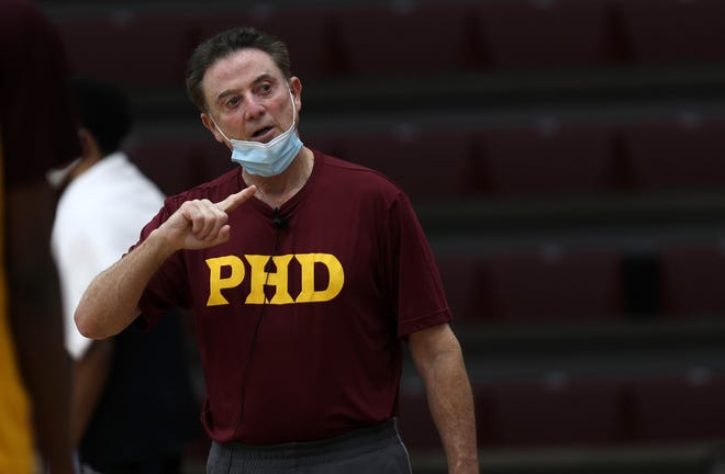 Iona basketball coach Rick Pitino runs a practice with his team at Iona College in New Rochelle, N.Y., earlier this month. With a homecoming of sorts, the Long Island native has begun his comeback — three years after scandals and investigation brought an abrupt end to the Hall of Fame coach's tenure at Louisville.