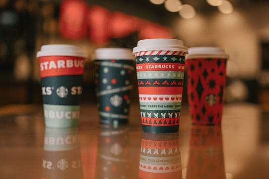 Starbucks brings back the red mugs and holiday drinks starting Friday.  To get a free reusable holiday cup on Friday, order any size craft holiday drinks while stock availability.