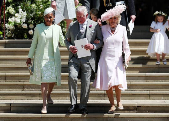 Prince Charles flanked by Meghan Markle's mother Doria Ragland, and his wife, Duchess Camilla of Cornwall, after the wedding of Prince Harry to Meghan at St George's Chapel, Windsor Castle, on May 19, 2018.