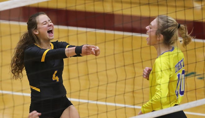 Coventry's Miya Gotto, left, celebrates with teammate Carly Wightman as the Comets increase their lead against Tallmadge during the third set of a Division II regional semifinal volleyball match, Thursday, Nov. 5, 2020, in Stow, Ohio. [Jeff Lange/Beacon Journal]