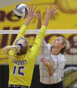 In a game last season, Tallmadge's Mia Hurst, facing, spikes the ball against Coventry's Ronnie Meinen during the first set of a Division II regional semifinal volleyball match, Thursday, Nov. 5, 2020, in Stow, Ohio. [Jeff Lange/Beacon Journal]