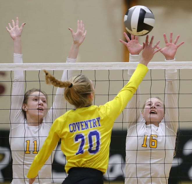 Tallmadge's Kendall Kirkland, left, and Ella Bee, right, look to defend a shot by Coventry's Carly Wightman during the first set of a Division II regional semifinal volleyball match, Thursday, Nov. 5, 2020, in Stow, Ohio. [Jeff Lange/Beacon Journal]