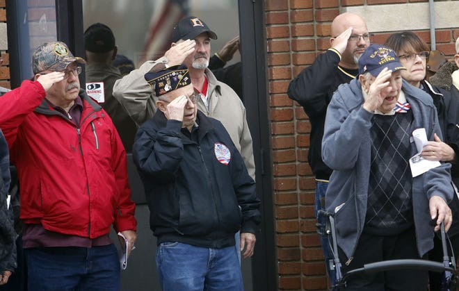 Jeff Blake, Homer Leiter, Jeff Drushel, Marke Moore and John Meyer salute during the playing of taps at the American Legion Post 88 Veterans Day program in 2019. Also pictured is Mary Cox, John Meyer's daughter. The Legion's Veterans Day service this year will be 10:30 a.m. Wednesday, Nov. 11.