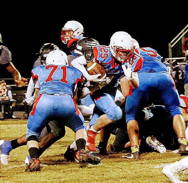 EBHS running back Jordan Plumley (25) breaks through the line during a recent game with Sterlington. The Trojans will take to the road at 7 p.m. Friday against the Oberlin Tigers.