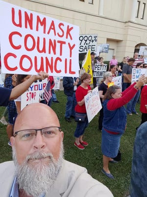 Beaufort County Councilman Mike Covert attended an anti-mask rally held at the Beaufort County Government Center in Beaufort on Thursday.