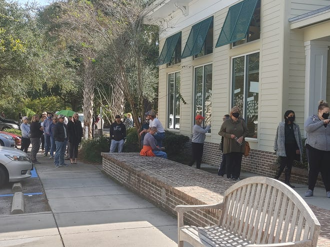 Voters at the Bluffton library Tuesday around noon said their wait was a little over an hour.