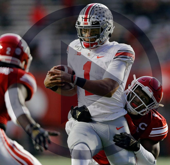 In this file photo, Ohio State Buckeyes quarterback Justin Fields (1) carries the ball on a run against Rutgers Scarlet Knights linebacker Tyreek Maddox-Williams (9) during the 2nd quarter of their game at SHI Stadium in Piscataway, N.J on November 16, 2019.
