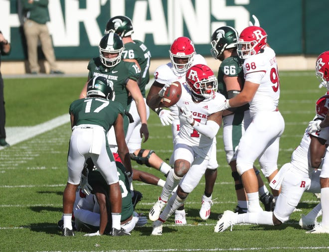 Rutgers safety Brendon White celebrates after recovering a fumble against Michigan State.