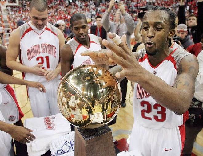 Ohio State's Je'Kel Foster, 23, relishes the moment after beating Purdue and the trophy presentation  an clinching the outright Big Ten title at Value City Arena, March 5, 2006.