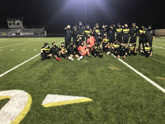 Nauset's boys soccer game celebrates an undefeated decision following a 9-0 win against Sandwich on Thursday at Nauset Regional High School in North Eastham. [Photo courtesy of John McCully]