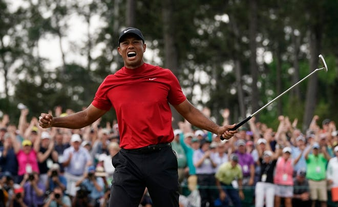 Tiger Woods celebrates winning the Masters in April 2019. Because of the coronavirus pandemic, the Masters is being held in November for the first time.