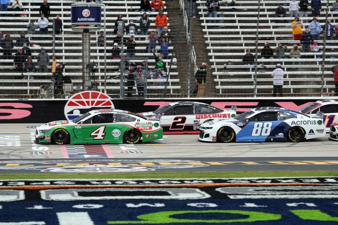 Kevin Harvick (4), Brad Keselowski (2) and Alex Bowman (88) begin a NASCAR Cup Series race at Texas Motor Speedway on Oct. 25.