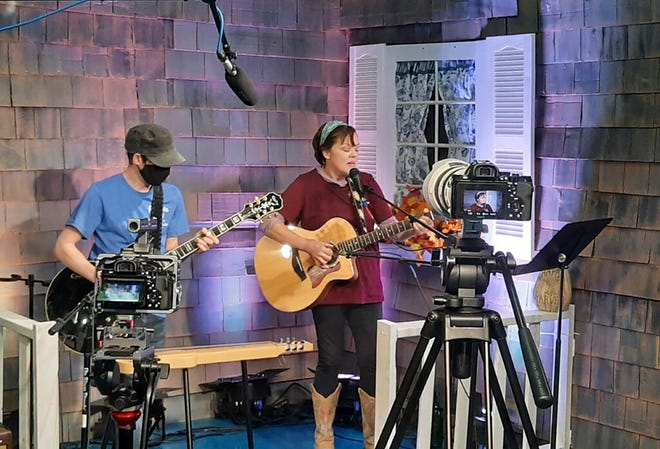Leslie Gage, right, and Mike Machaby perform on a porch stage for a virtual version of the Sandwich Arts Alliance's PorchFest concerts.