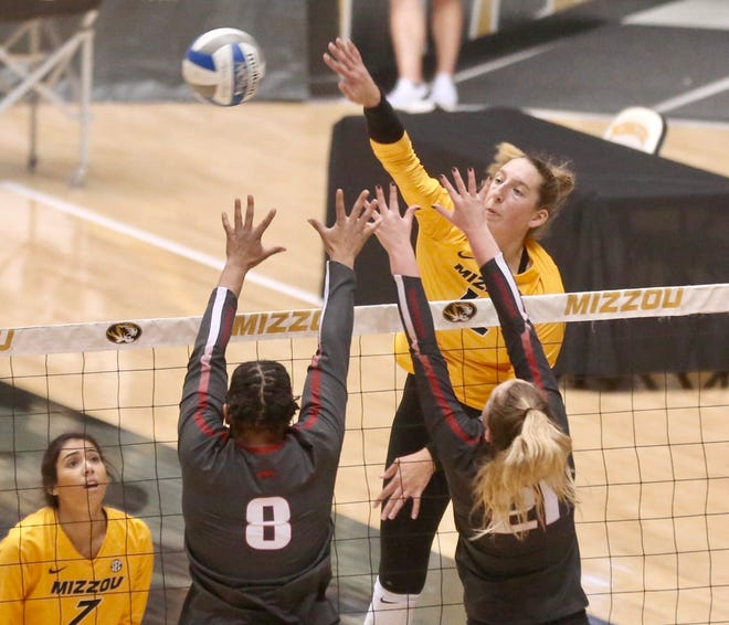 After a career night Wednesday with 28 kills and eight aces, Missouri senior outside hitter Kylie Deberg (12) backed it up with another double-double Thursday night against Arkansas with 20 kills and 13 digs at the Hearnes Center.