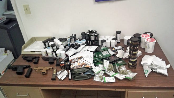 Nearly two pounds of marijuana and four guns were seized Thursday morning by the Missouri Highway Patrol in Cooper County after a traffic stop. Four suspects from out-of-state were arrested.
