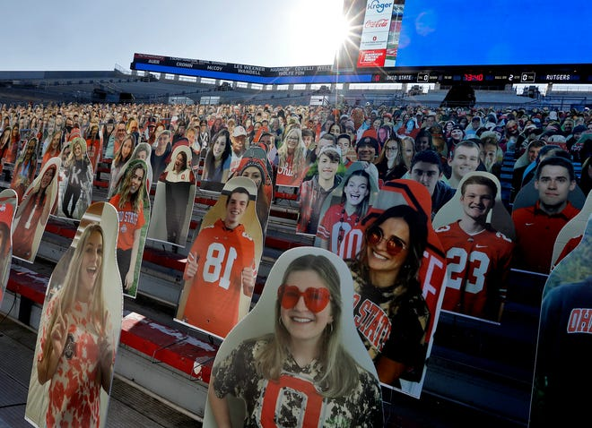Student cutouts crowd the south end zone at Ohio Stadium on Friday in anticipation of the Buckeyes' game against Rutgers on Saturday.