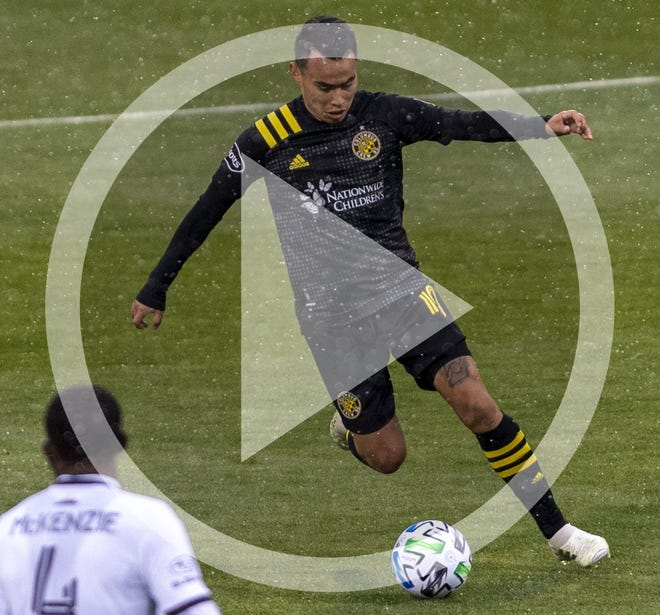 In this file photo, Columbus Crew SC midfielder Lucas Zelarrayan (10) dribbles down the field during the first half of the Crew's game against Philadelphia Union at MAPFRE Stadium in Columbus, Ohio, on Nov.1, 2020.