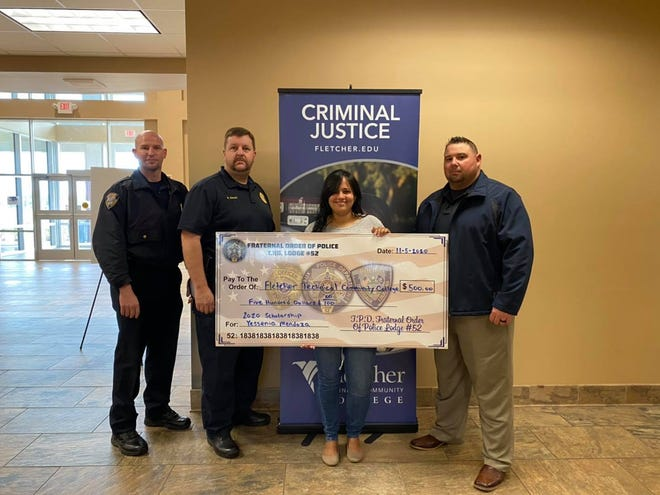 Thibodaux Police present Yessenia Mendoza with a $500 scholarship.