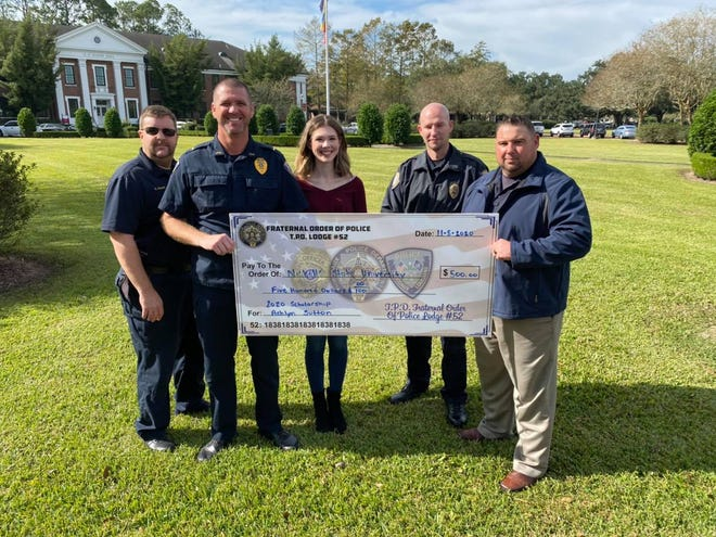 Ashlyn Sutton is presented a $500 scholarship by the Thibodaux Police Department.