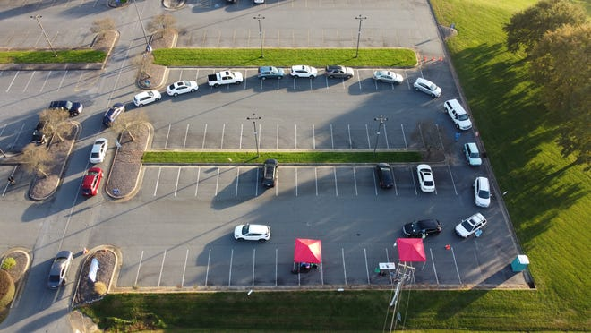 Cars line up at a drive-thru COVID-19 testing site at Randolph Community College on Thursday, Nov. 5, 2020.