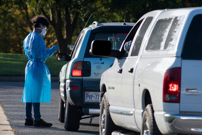 A health care worker greets drivers at the entrance of a drive-thru COVID-19 testing site at Randolph Community College on Nov. 5. Another such drive-thru event is scheduled for Nov. 18 at Creekside Park in Archdale.