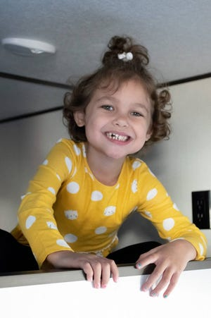 Alayna Numbers claimed the top bunk as hers in the new travel trailer she was granted through the Make-A-Wish Foundation. Stoney's RV of Cambridge provided the camper.