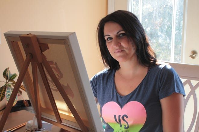 Painter Jennifer Moore is a social worker who uses her skills as an artist to help her clients through art therapy.