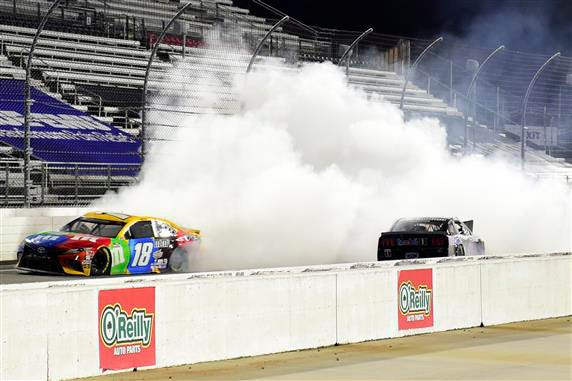 Kyle Busch, driver of the #18 M&M's Toyota, drives with smoke after an on-track incident with Kevin Harvick, driver of the #4 Mobil 1 Ford, on the last lap during the NASCAR Cup Series Xfinity 500 at Martinsville Speedway in Martinsville, Virginia.