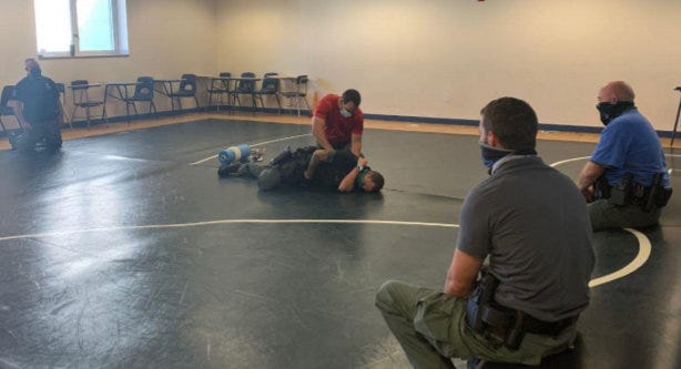 Flagler County Sheriff's Office Deputy 1st Class Sam Bell demonstrates first aid on Tuesday during training for school resource deputies at Buddy Taylor Middle School in Palm Coast.