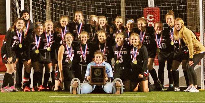 Honesdale's girls varsity field hockey team captured the first District Two championship in school history with a wild 3-2 victory over Hazleton Area. The Lady Hornets now advance to the PIAA state tournament. Pictured here are coaches Becca Maciejewski, Grace Ruckinger and their players sporting Class AAA gold medals.