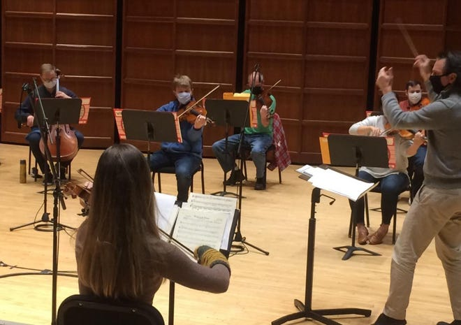 "Music Director Daniel Meyer, right, leads Erie Philharmonic musicians in a rehearsal of Harry Burleigh spirituals arranged for orchestra. The music will be featured in the orchestra's ""Americana"" concert."