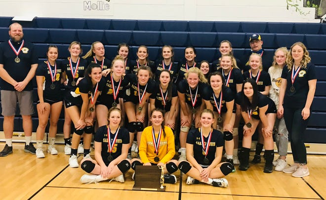 The Saegertown girls volleyball team poses with its District 10 Class 1A championship trophy after beating Cochranton on Thursday night at Saegertown.