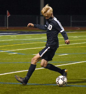 Central Valley Academy senior Adin Day, pictured playing in an Oct. 15 match against Utica-Notre Dame, broke his tie with Tanner Cook for the school's single-season goal-scoring record with the first of his two goals Thursday against Camden.