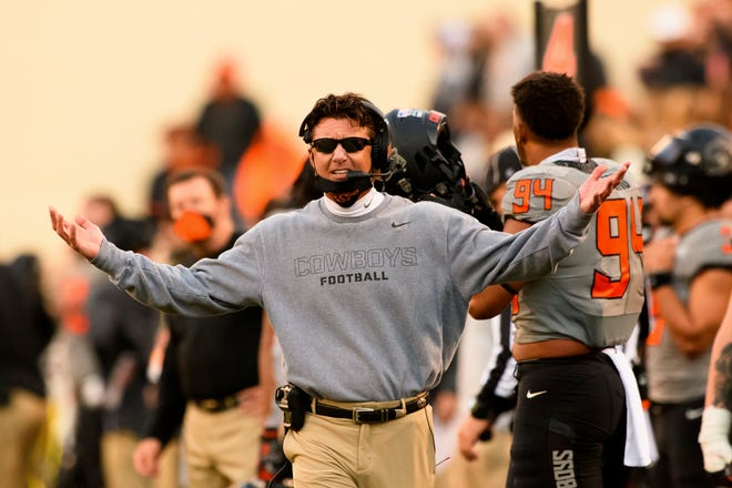 Oklahoma State head coach Mike Gundy gestures to an official during the last quarter of an Oct. 24 game